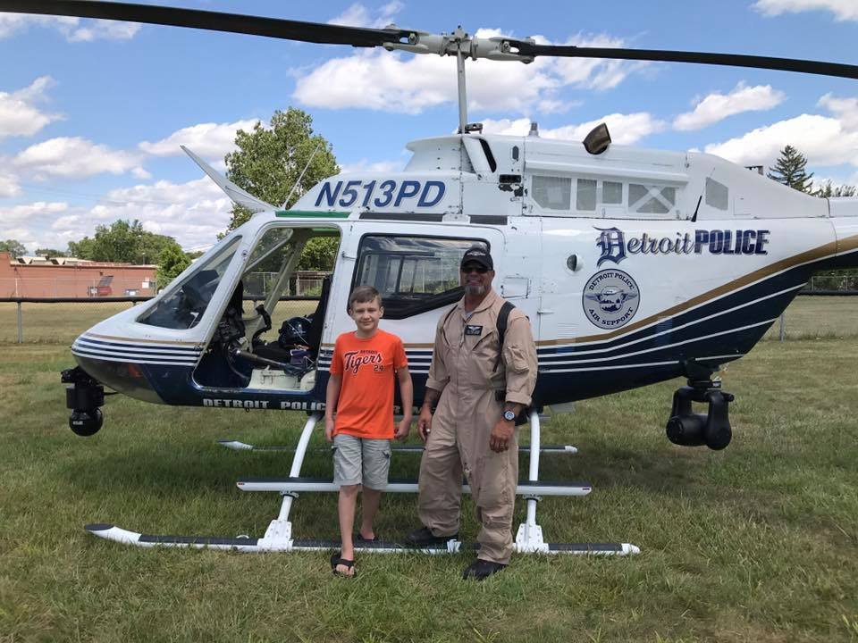 CS Family member Logan with Helicopter pilot