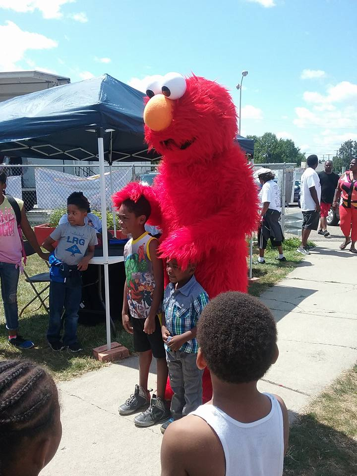Elmo with two kids