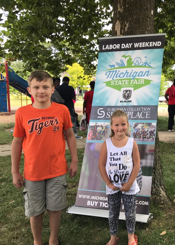 Kids by Michigan State Fair Sign