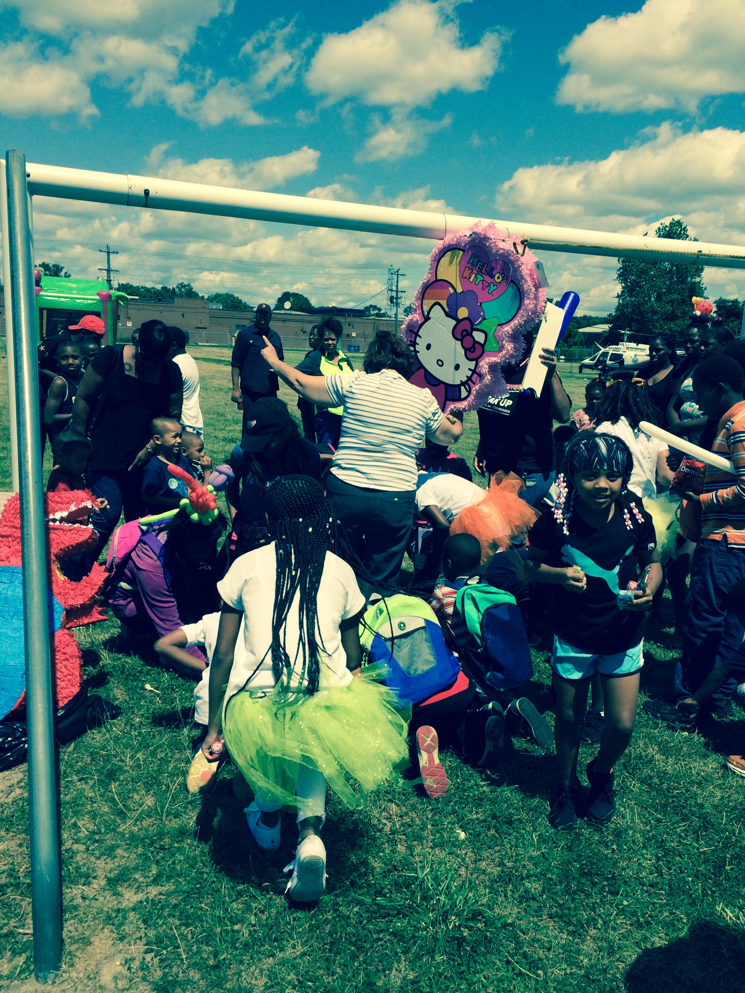 Kids getting candy from Pinata