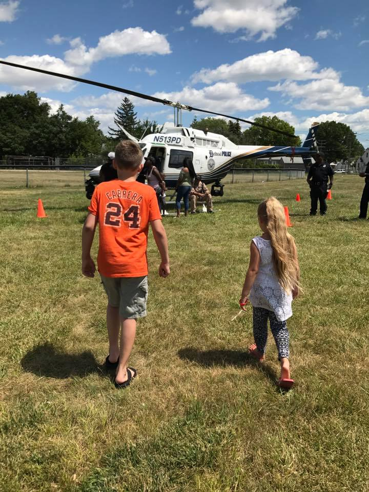 Kids walking towards helicopter