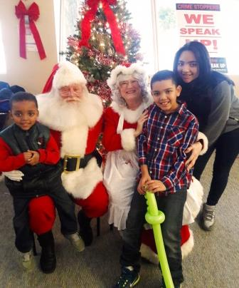 Annual Christmas Party - Tony Dedvukaj and his kids with Santa and Mrs. Claus