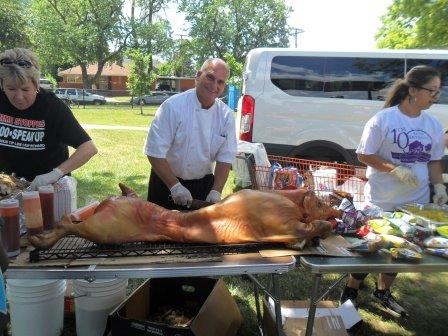 Annual Picnic - Neighborhoods Day - Chef with the roasted pig