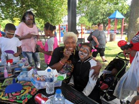 Annual Picnic - Neighborhoods Day - Little girl getting face painted