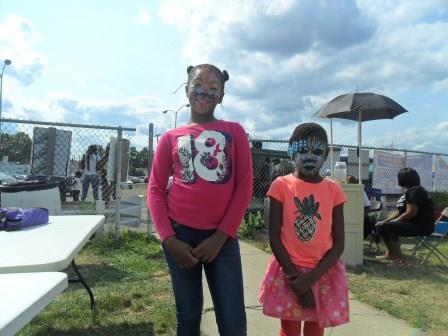 Annual Picnic - Neighborhoods Day - Two little girls with face painted